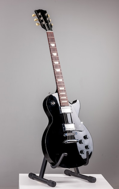 Electric guitar on gray background Free Photo