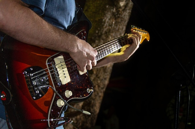 Electric guitar player, closeup photo with soft selective focus Premium Photo