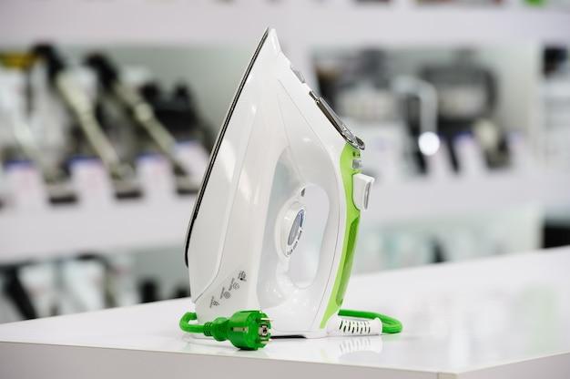 Electric iron in retail store Premium Photo