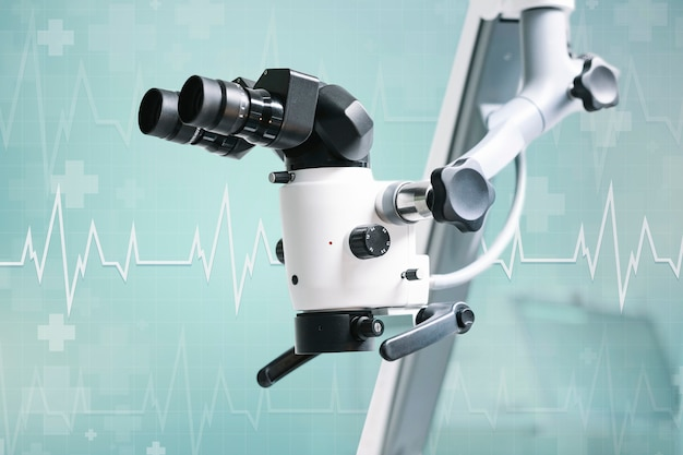 Electric microscope with teal background Free Photo