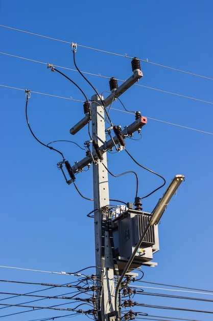 Electric pole connect to the high voltage electric wires on against ...