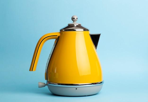Electric vintage retro kettle on a colored blue. lifestyle and design concept Premium Photo