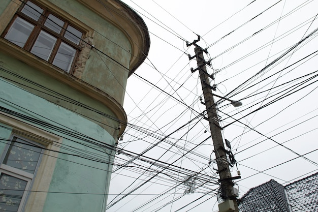 Electric wires on a city street against the sky Photo | Premium Download