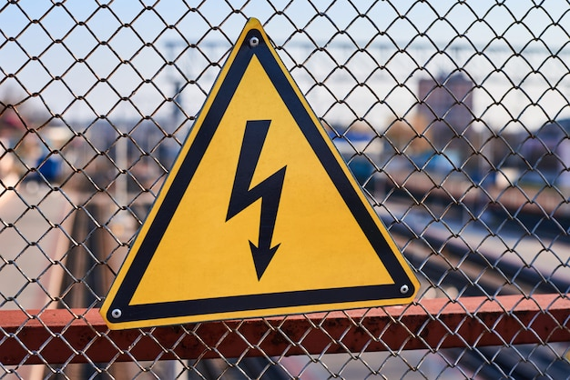 Electrical hazard sign. lightning on yellow background close up. Premium Photo