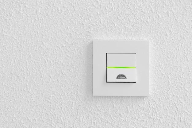 Electrical light switch on white Premium Photo