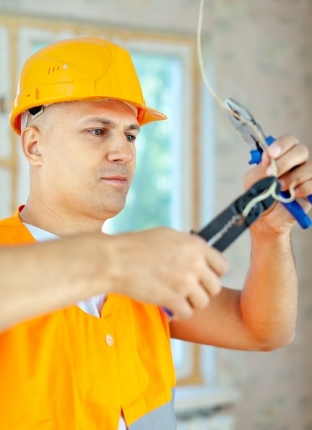 Electrician installing electricity Free Photo