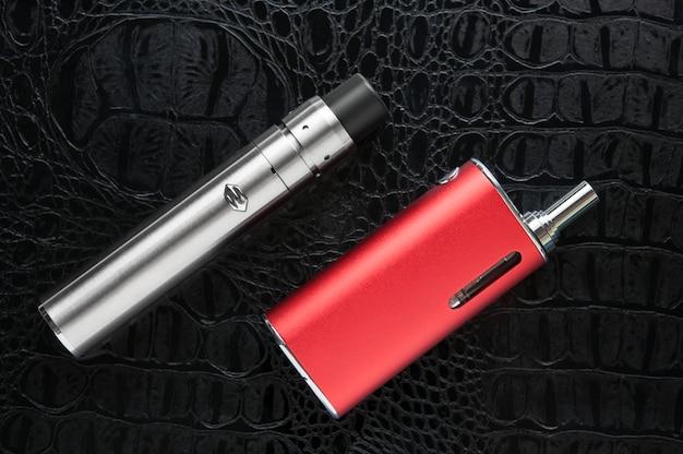 Electronic cigarette on black background. Premium Photo