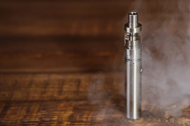 Electronic cigarette on a wooden table. Premium Photo