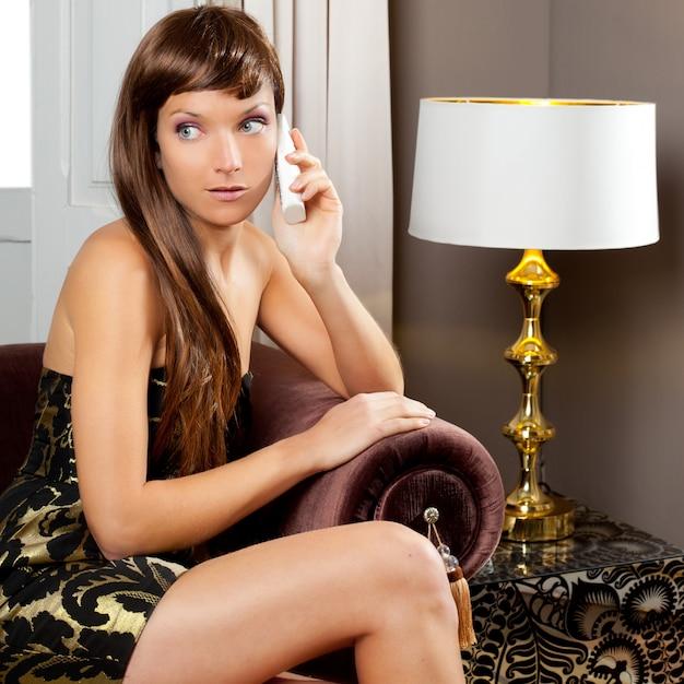 Elegance fashion woman talking telephone in sofa Premium Photo