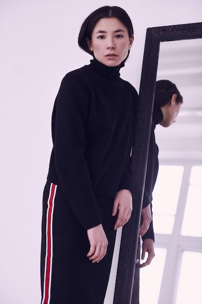 Elegant asian woman in fashionable black skirt Premium Photo