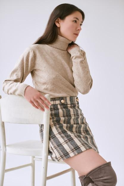 Elegant asian woman in fashionable woolen skirt Premium Photo