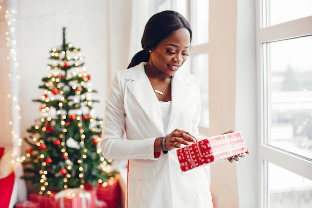 Elegant black girl in the christmas decorations Free Photo
