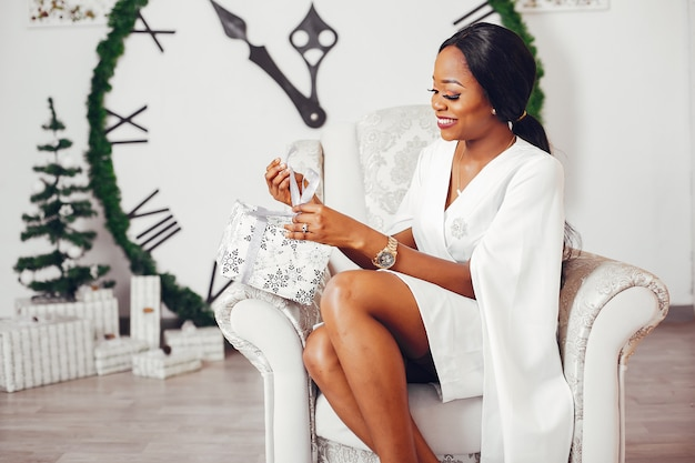 Elegant black girl in a room at christmas Free Photo