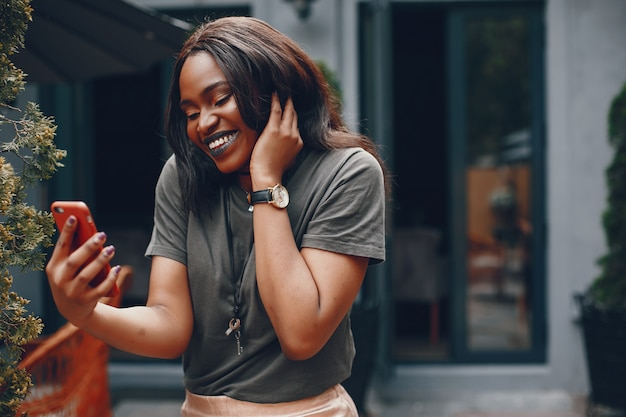 Elegant black girl in a summer city Free Photo