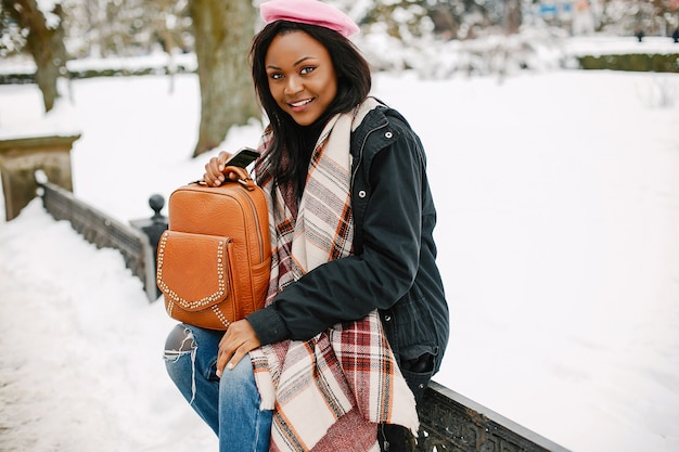Elegant black girl in a winter city Free Photo
