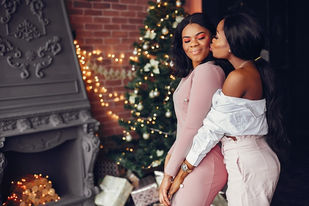 Elegant black girls in the christmas decorations Free Photo