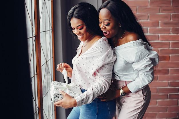 Elegant black girls in the christmas decorations Free Photo