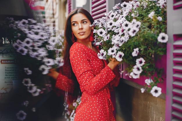 Elegant brunette in a summer city Free Photo