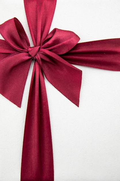 Elegant burgundy ribbon on white background Premium Photo
