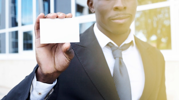 Elegant businessman presenting business card Free Photo