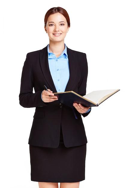 Elegant businesswoman reviewing the agenda Free Photo