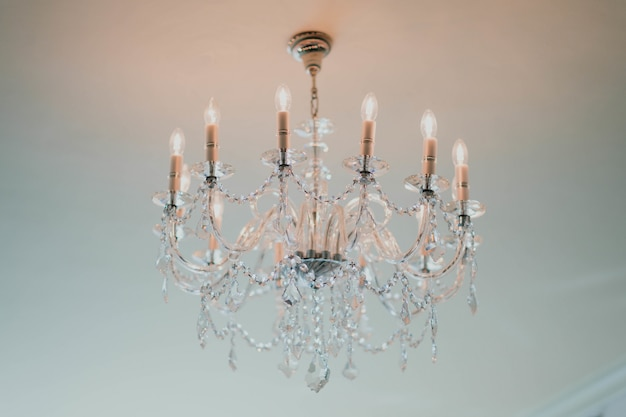 Elegant chandelier hanging from the ceiling Free Photo
