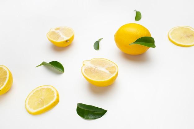 Elegant composition of set of lemons on a white surface Free Photo