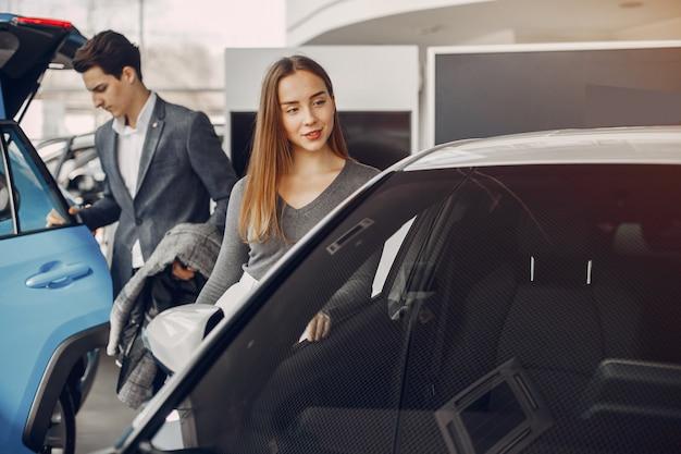 Elegant couple in a car salon Free Photo