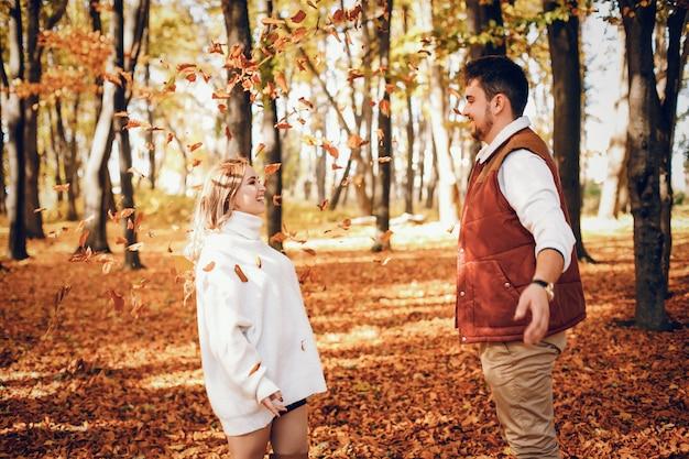 Elegant couple in a sunny autumn park Free Photo