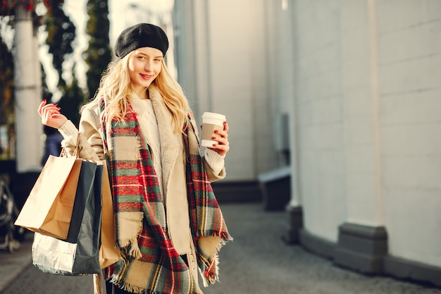 Elegant cute blonde walking in a city Free Photo