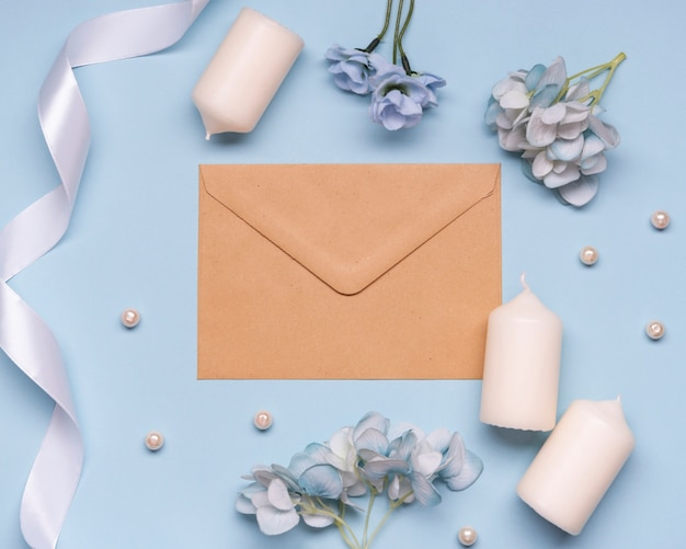 Elegant envelope and wedding candles on the table Free Photo