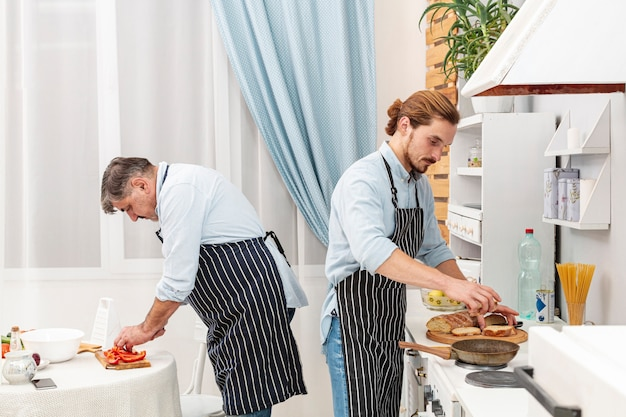 Elegant father and son cooking Free Photo