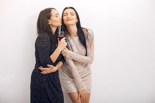 Elegant girls celebrate in the studio Free Photo