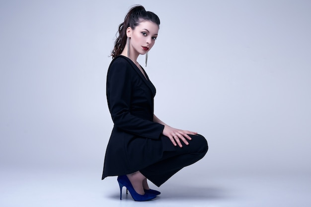 Elegant gothic brunette woman with red lips in black suit Premium Photo