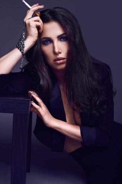 Premium Photo | Elegant hot brunette woman smoking a cigarette