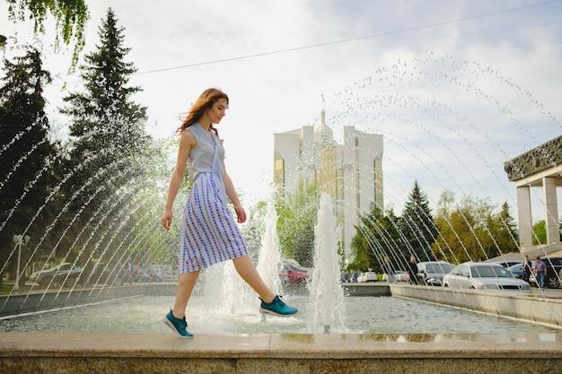 Elegant lady walking alone in the street Free Photo