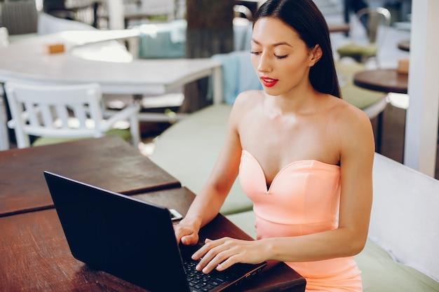 Elegant lady with laptop Free Photo