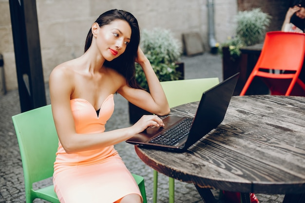 Elegant lady with laptop Free Photo