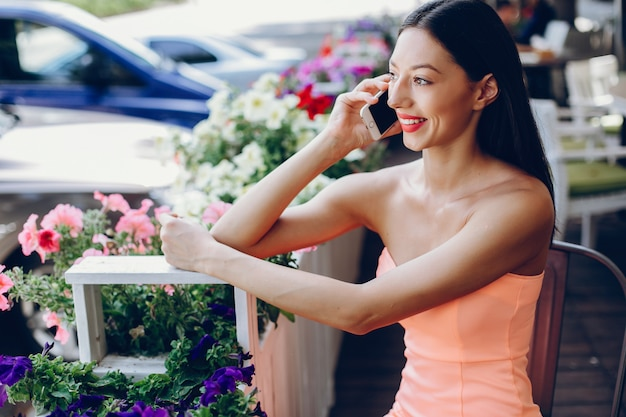 Elegant lady with mobile phone Free Photo