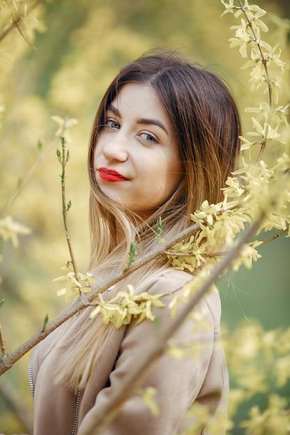 Elegant little girl in a spring park Free Photo