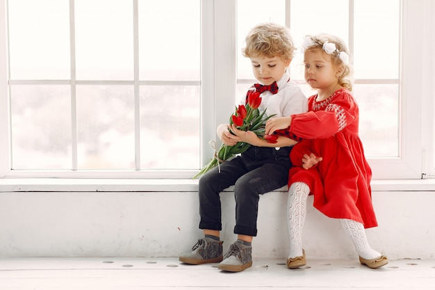 Elegant little kids with bouquet of tulip Free Photo