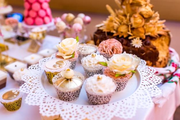 Elegant and luxurious event arrangement with colorful pastries Premium Photo