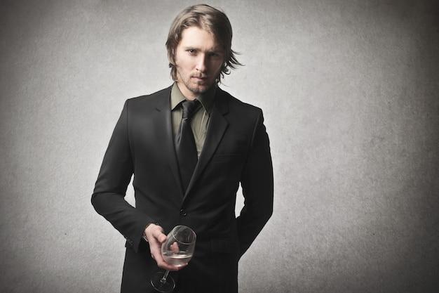Elegant man holding a glass Premium Photo