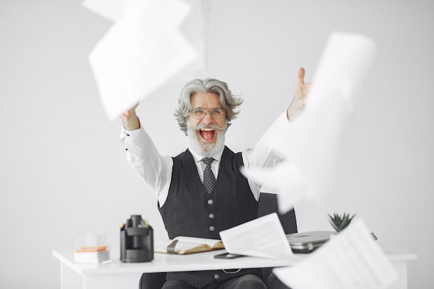Elegant man in office. businessman in white shirt. man works with documents. Free Photo