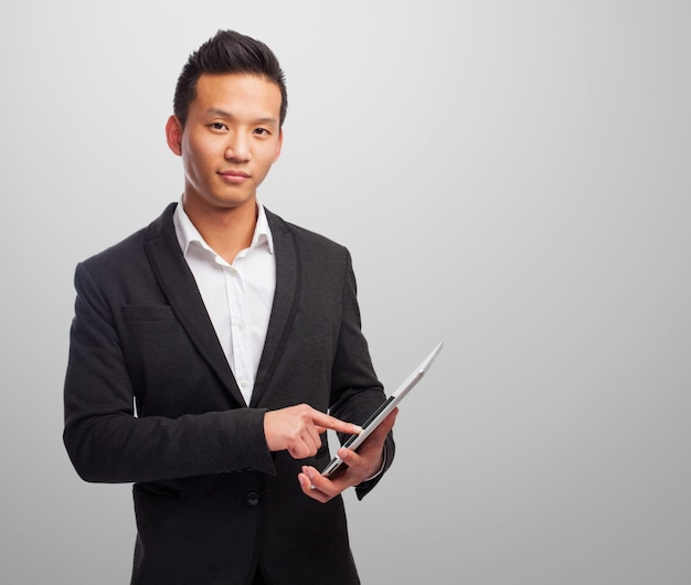 Elegant man with a tablet Free Photo