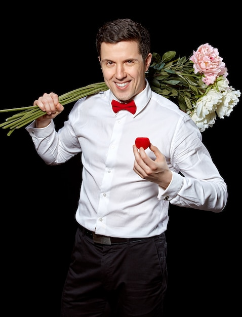 The elegant man with a ring and flowers Free Photo