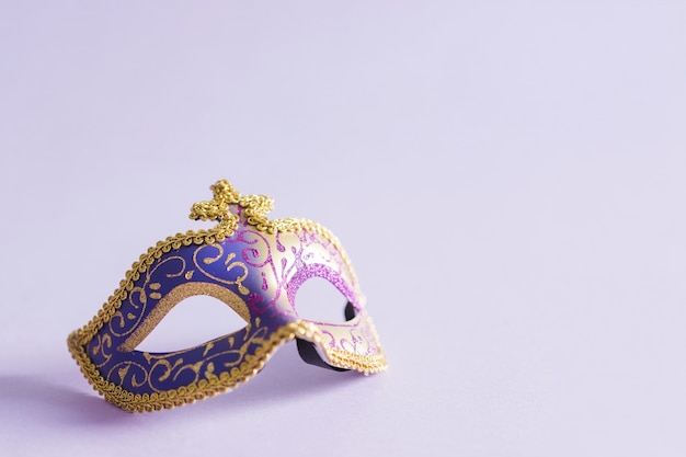 Elegant mask on lilac Free Photo