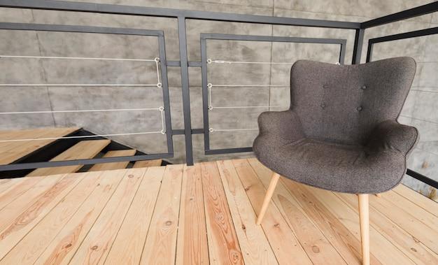 Elegant modern armchair on wooden stand Free Photo