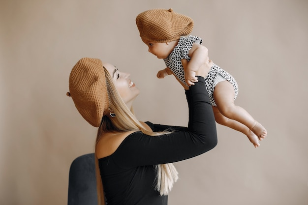 Elegant mother with cute little daughter Free Photo