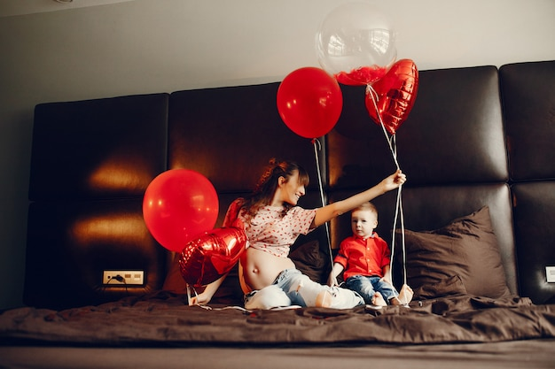 Elegant mother with little son in a bed Free Photo